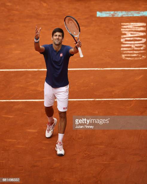 Novak Djokovic of Serbia celebrates defeating Nicolas Almagro of Spain during day five of the Mutua Madrid Open tennis at La Caja Magica on May 10...