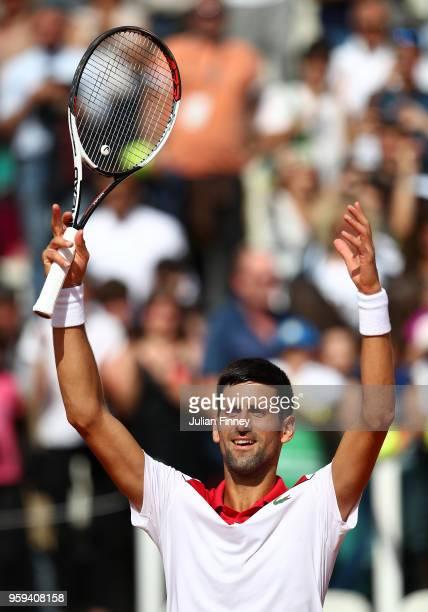 Novak Djokovic of Serbia celebrates defeating Nikoloz Basilashvili of Georgia during day four of the Internazionali BNL d'Italia 2018 tennis at Foro...