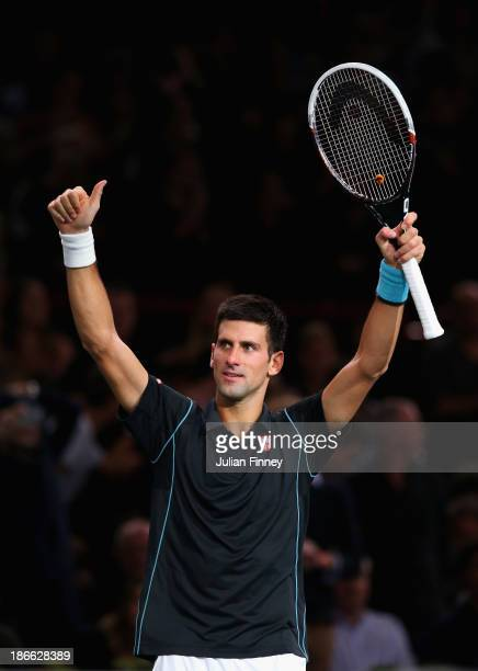 Novak Djokovic of Serbia celebrates defeating Roger Federer of Switzerland during day six of the BNP Paribas Masters at Palais Omnisports de Bercy on...