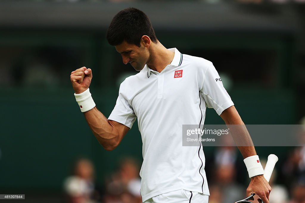 Novak Djokovic of Serbia celebrates during his Gentlemen's Singles second round match against Radek Stepanek of Czech Republic on day three of the Wimbledon Lawn Tennis Championships at the All England Lawn Tennis and Croquet Club at Wimbledon on June 25, 2014 in London, England.