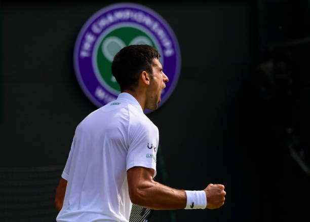 Novak Djokovic of Serbia celebrates during his match against Denis Kudla of the United States in the third round of the gentlemen's singles during...