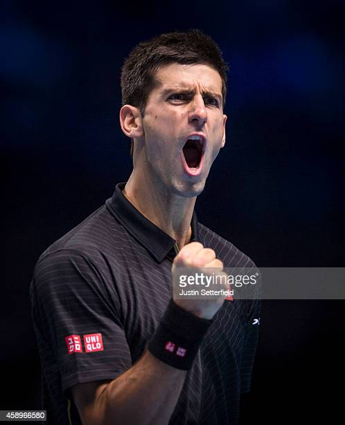 Novak Djokovic of Serbia celebrates during the round robin singles match against Tomas Berdych of Czech Republic on day six of the Barclays ATP World...