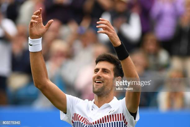 Novak Djokovic of Serbia celebrates his victory during the men's singles quarter final match against Donald Young of The United States on day five of...