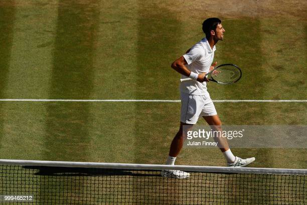 Novak Djokovic of Serbia celebrates his victory over Kevin Anderson of South Africa after the Men's Singles final on day thirteen of the Wimbledon...