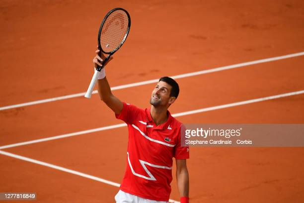 Novak Djokovic of Serbia celebrates his victory over Ricardas Berankis of Lithuania in the second round of the men's singles at Roland Garros on...