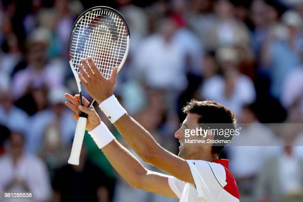 Novak Djokovic of Serbia celebrates his win during his men's singles quarterfinal match against Adrian Mannarino of France on Day Five of the...
