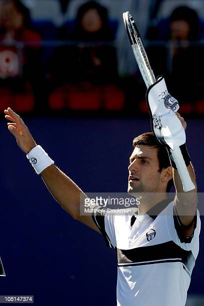 Novak Djokovic of Serbia celebrates his win over David Ferrer of Spain during the final on day eleven of the 2010 China Open at the National Tennis...