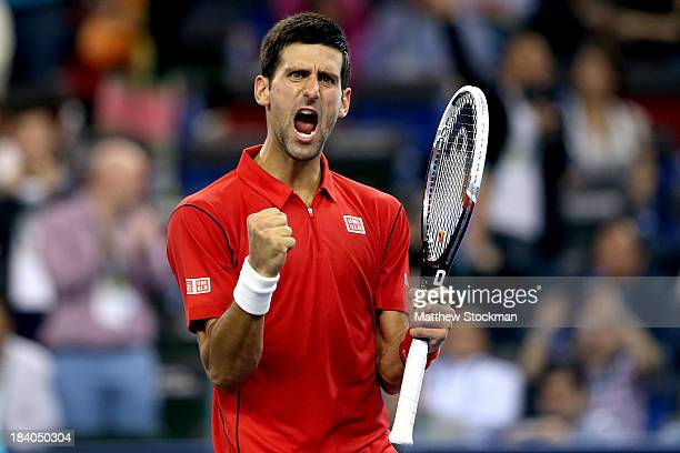 Novak Djokovic of Serbia celebrates his win over Gael Monfils of France during the Shanghai Rolex Masters at the Qi Zhong Tennis Center on October...