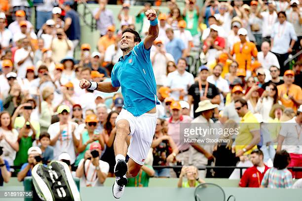 Novak Djokovic of Serbia celebrates his win over Kei Nishikori of Japan during the final on Day 14 of the Miami Open presented by Itau at Crandon...