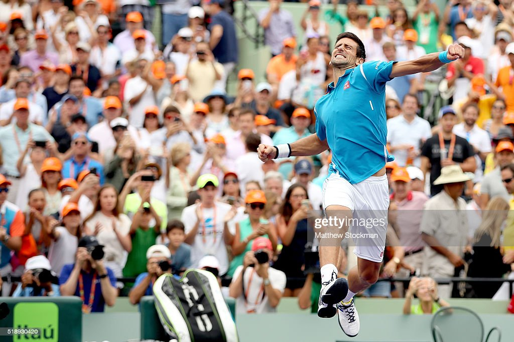 Novak Djokovic of Serbia celebrates his win over Kei Nishikori of Japan during the final on Day 14 of the Miami Open presented by Itau at Crandon Park Tennis Center on April 3, 2016 in Key Biscayne, Florida.
