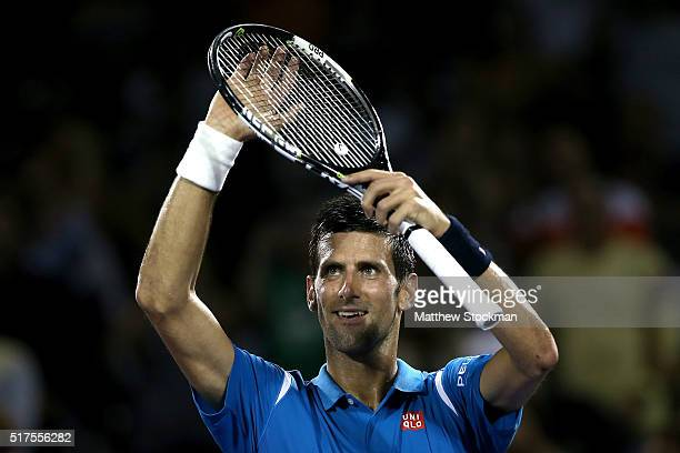 Novak Djokovic of Serbia celebrates his win over Kyle Edmund of Great Britain during the Miami Open presented by Itau at Crandon Park Tennis Center...