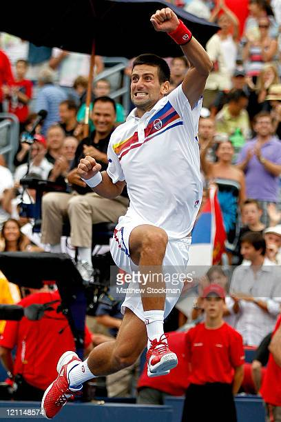 Novak Djokovic of Serbia celebrates his win over Mardy Fish of the United States in the final of the Rogers Cup at Uniprix Stadium on August 14 2011...