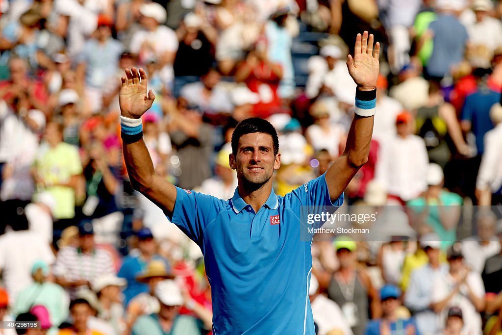 Novak Djokovic of Serbia celebrates his win over Roger Federer of Switzerland during the final on day fourteen of the BNP Paribas Open at the Indian Wells Tennis Garden on March 22, 2015 in Indian Wells, California.