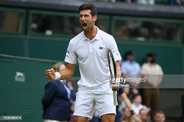 Novak Djokovic of Serbia celebrates in his Men's Singles Second Round match against Kevin Anderson of South Africa during Day Three of The...