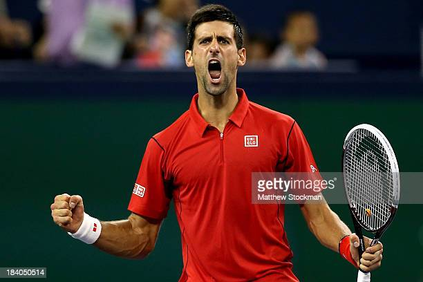 Novak Djokovic of Serbia celebrates match point against Gael Monfils of France during the Shanghai Rolex Masters at the Qi Zhong Tennis Center on...