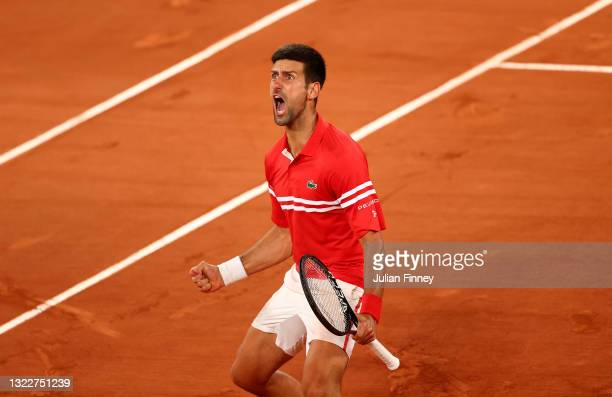 Novak Djokovic of Serbia celebrates match point and victory during his Mens Singles Quarter-Final match against Matteo Berrettini of Italy during Day...