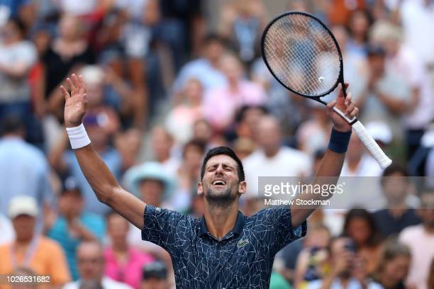 Novak Djokovic of Serbia celebrates match point during the men's singles fourth round match against Jaoa Sousa of Portugal on Day Eight of the 2018...