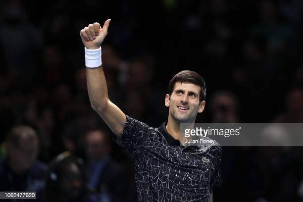 Novak Djokovic of Serbia celebrates match point in his third singles round robin match against Marin Cilic of Croatia during Day Six of the Nitto ATP...
