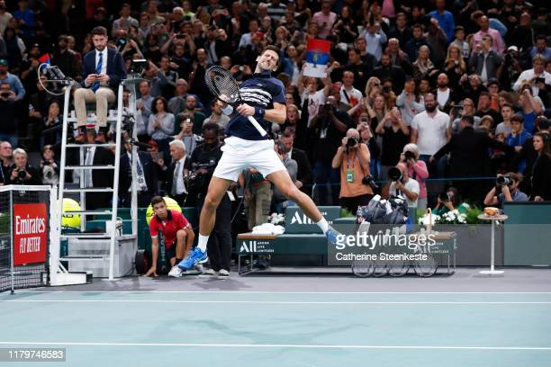 Novak Djokovic of Serbia celebrates the victory of the final match against Denis Shapovalov of Canada on day 7 of the Rolex Paris Masters, part of...