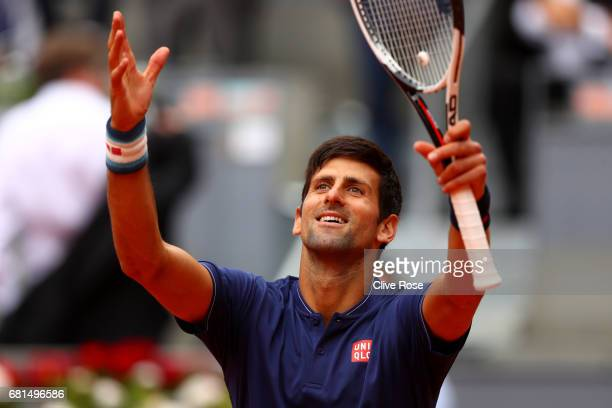 Novak Djokovic of Serbia celebrates to the crowd after beating Nicolas Almagro of Spain during day five of the Mutua Madrid Open tennis at La Caja...