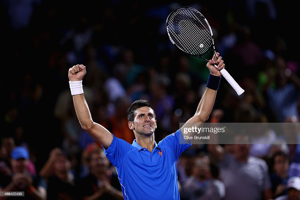 Novak Djokovic of Serbia celebrates to the crowd after his straight sets victory against David Ferrer of Spain in their quarter final during the Miami Open Presented by Itau at Crandon Park Tennis Center on April 2, 2015 in Key Biscayne, Florida.
