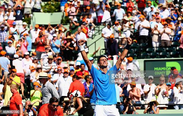 Novak Djokovic of Serbia celebrates to the crowd after his three set victory against Andy Murray of Great Britain in the mens final during the Miami...