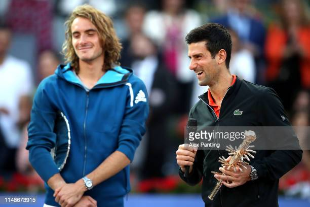 Novak Djokovic of Serbia celebrates victory as he poses with the winners trophy following the men's singles final against Stefano Tsitsipas of Greece...