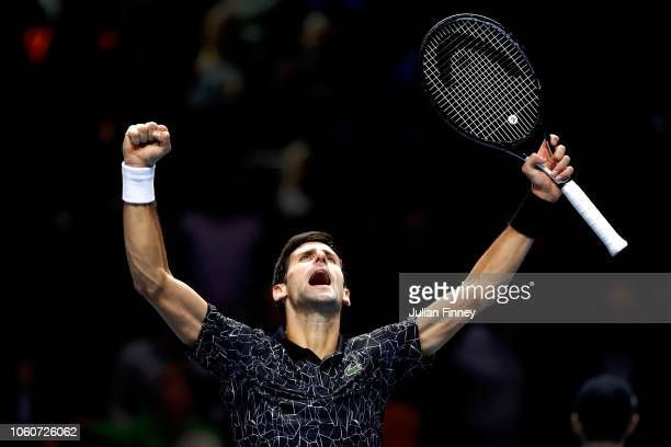 Novak Djokovic of Serbia celebrates victory during his singles round robin match against John Isner of The United States during Day Two of the Nitto...