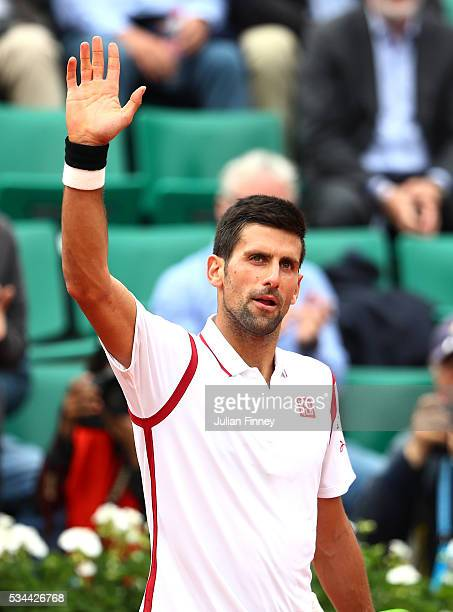 Novak Djokovic of Serbia celebrates victory during the Men's Singles second round match against Steve Darcis of Belgium on day five of the 2016...