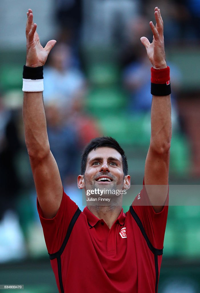 Novak Djokovic of Serbia celebrates victory during the Men's Singles third round match against Aljaz Bedene of Great Britain on day seven of the 2016 French Open at Roland Garros on May 28, 2016 in Paris, France.