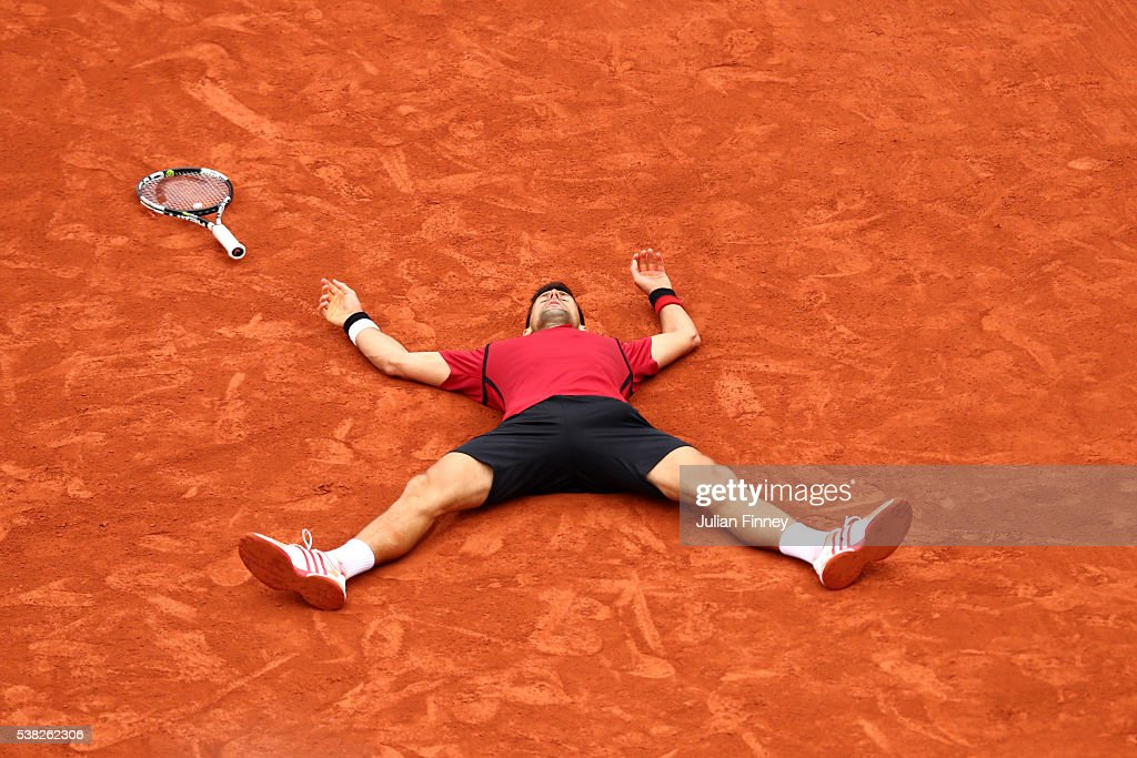 Novak Djokovic of Serbia celebrates victory during the Men's Singles final match against Andy Murray of Great Britain on day fifteen of the 2016 French Open at Roland Garros on June 5, 2016 in Paris, France.
