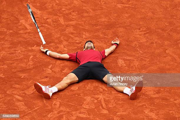 Novak Djokovic of Serbia celebrates victory during the Men's Singles final match against Andy Murray of Great Britain on day fifteen of the 2016...