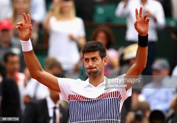 Novak Djokovic of Serbia celebrates victory following the mens singles third round match against Diego Schwartzman of Argentina on day six of the...