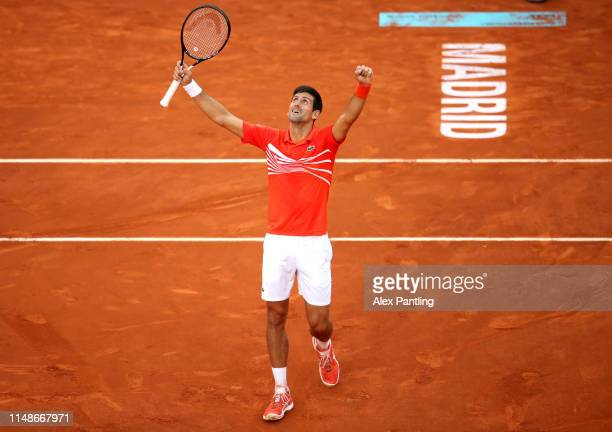 Novak Djokovic of Serbia celebrates victory in his men's singles final against Stefano Tsitsipas of Greece during day nine of the Mutua Madrid Open...