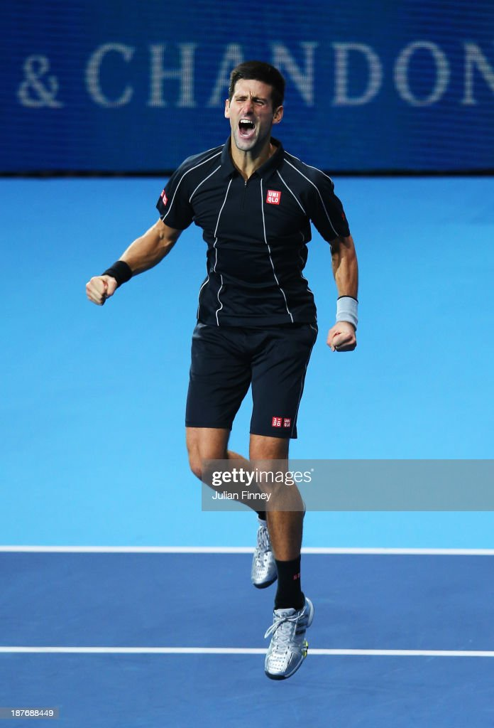 Novak Djokovic of Serbia celebrates victory in his men's singles final match against Rafael Nadal of Spain during day eight of the Barclays ATP World Tour Finals at O2 Arena on November 11, 2013 in London, England.