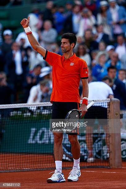 Novak Djokovic of Serbia celebrates victory in his Men's Singles match against Richard Gasquet of France on day nine of the 2015 French Open at...