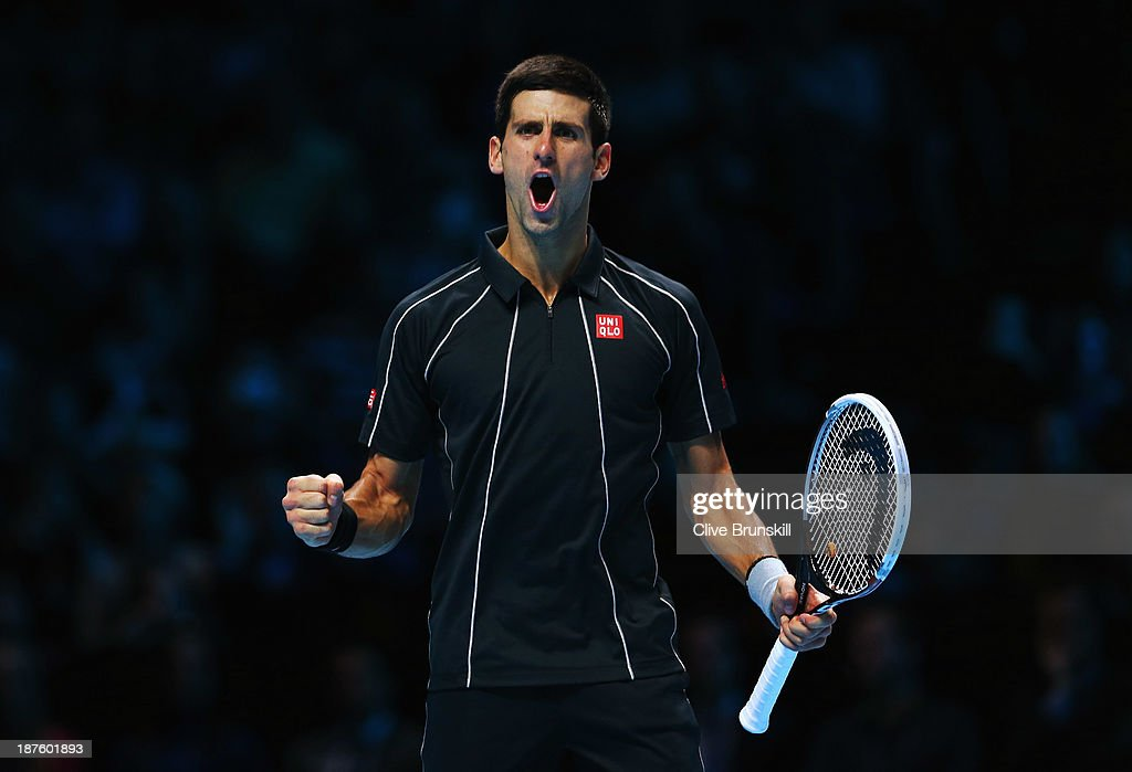 Novak Djokovic of Serbia celebrates victory in his men's singles semi-final match against Stanislas Wawrinka of Switzerland during day seven of the Barclays ATP World Tour Finals at O2 Arena on November 10, 2013 in London, England.