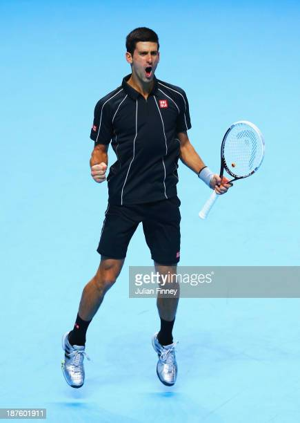 Novak Djokovic of Serbia celebrates victory in his men's singles semifinal match against Stanislas Wawrinka of Switzerland during day seven of the...