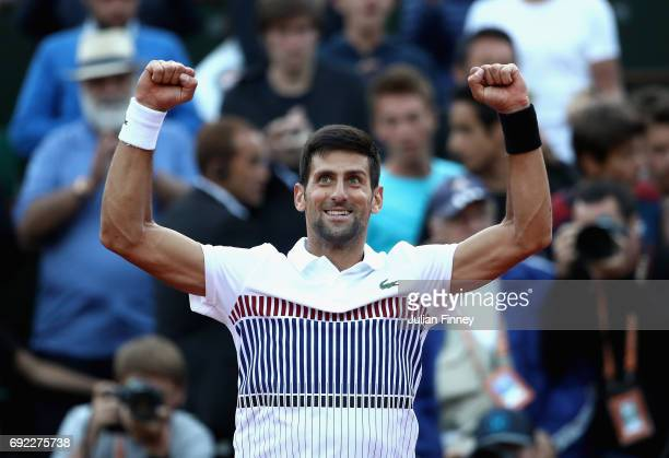 Novak Djokovic of Serbia celebrates victory in his mens singles fourth round match against Albert RamosVinolas of Spain on day eight of the 2017...