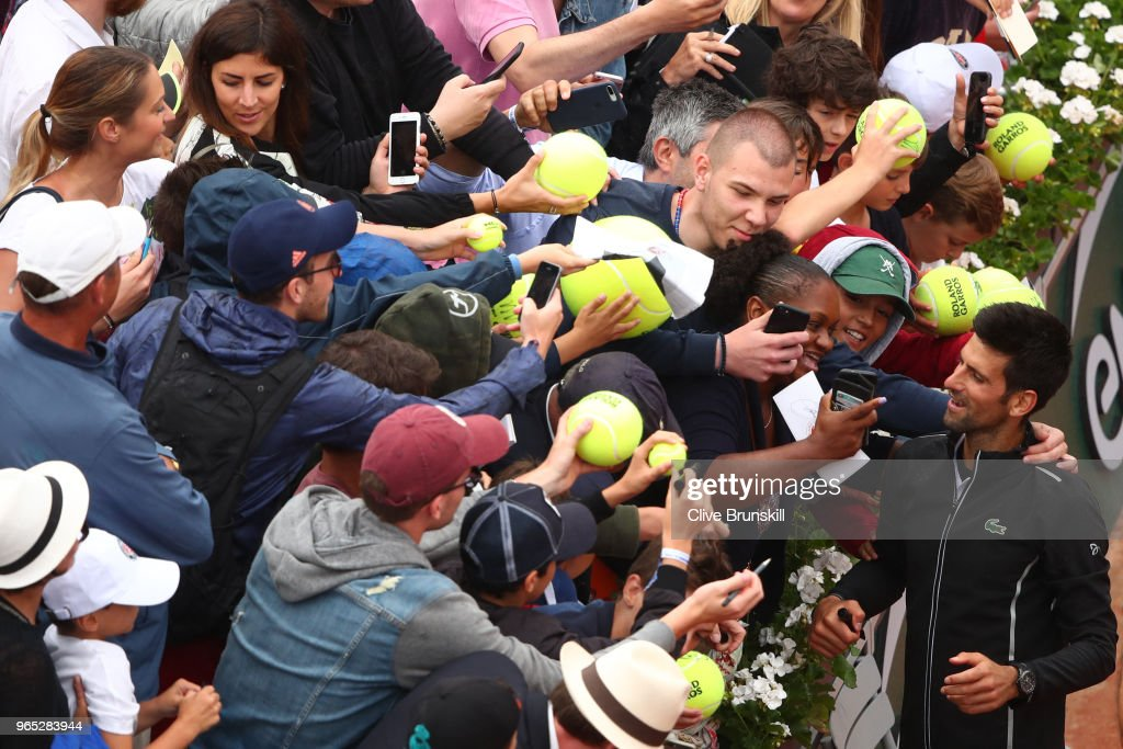 Novak Djokovic of Serbia celebrates victory with supporters durng his mens singles third round match against Roberto Bautista Agut of Spain during day six of the 2018 French Open at Roland Garros on June 1, 2018 in Paris, France.