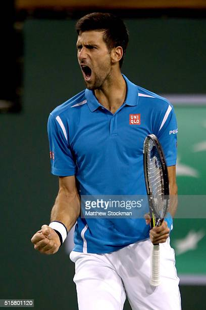 Novak Djokovic of Serbia celebrates while playing Philipp Kohlschreiber of Germany during the BNP Paribas Open at the Indian Wells Tennis Garden on...