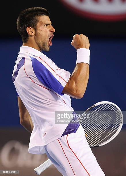 Novak Djokovic of Serbia celebrates winning a break point in his quarterfinal match against Tomas Berdych of the Czech Republic during day nine of...
