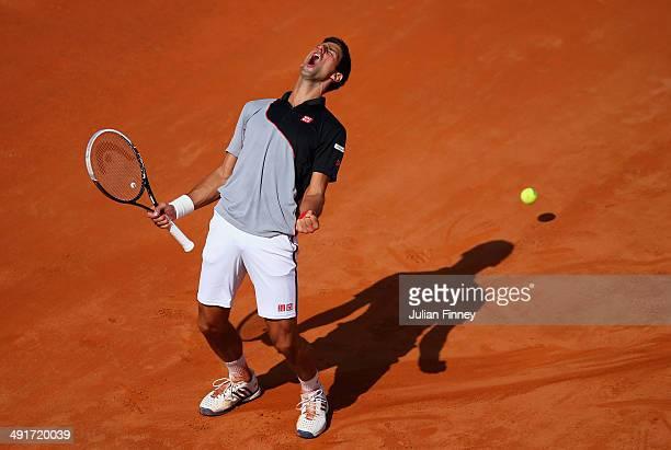 Novak Djokovic of Serbia celebrates winning a game against Milos Raonic of Canada during day seven of the Internazionali BNL d'Italia tennis 2014 on...
