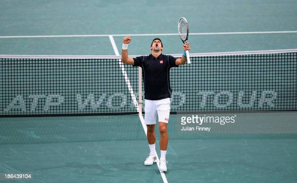 Novak Djokovic of Serbia celebrates winning a point against John Isner of USA during day four of the BNP Paribas Masters at Palais Omnisports de...