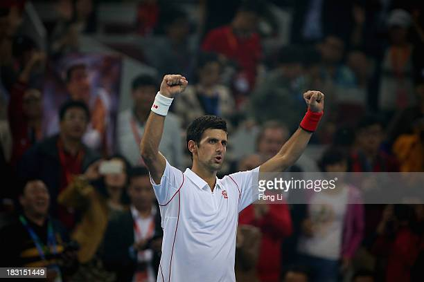 Novak Djokovic of Serbia celebrates winning against Richard Gasquet of France during their men's semifinal match of the 2013 China Open at the...