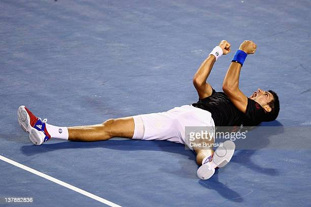 Novak Djokovic of Serbia celebrates winning championship point in his men's final match against Rafael Nadal of Spain during day fourteen of the 2012...