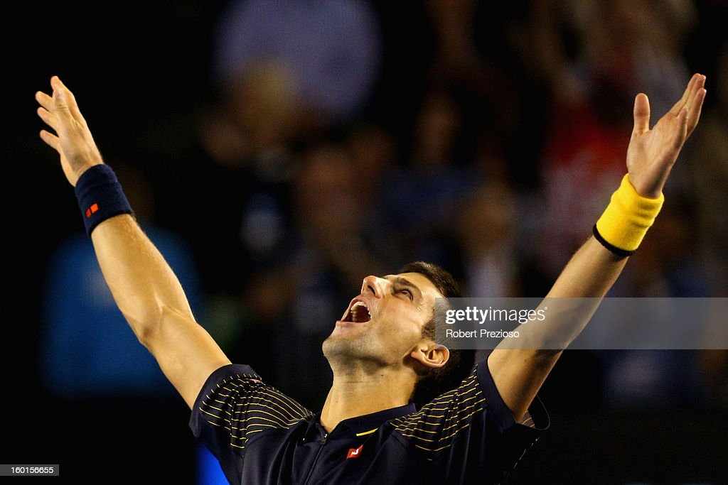Novak Djokovic of Serbia celebrates winning championship point in his men's final match against Andy Murray of Great Britain during day fourteen of the 2013 Australian Open at Melbourne Park on January 27, 2013 in Melbourne, Australia.