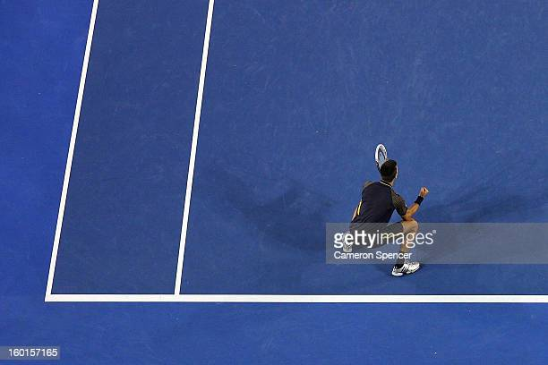 Novak Djokovic of Serbia celebrates winning championship point in his men's final match against Andy Murray of Great Britain during day fourteen of...