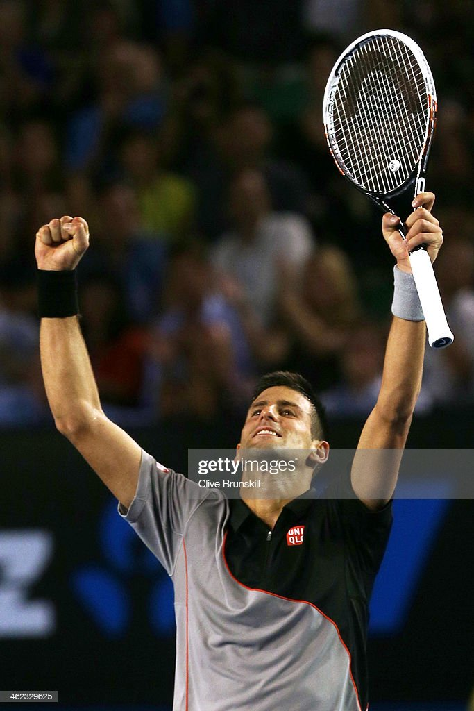 Novak Djokovic of Serbia celebrates winning his first round match against Lukas Lacko of Slovakia during day one of the 2014 Australian Open at Melbourne Park on January 13, 2014 in Melbourne, Australia.