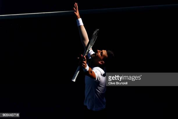 Novak Djokovic of Serbia celebrates winning his first round match against Donald Young of the United States on day two of the 2018 Australian Open at...
